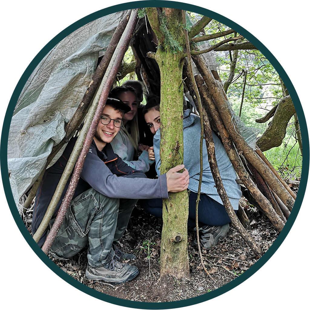 group taking shelter under a makeshift tent
