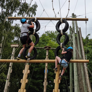 girl and boy navigating obstacle course