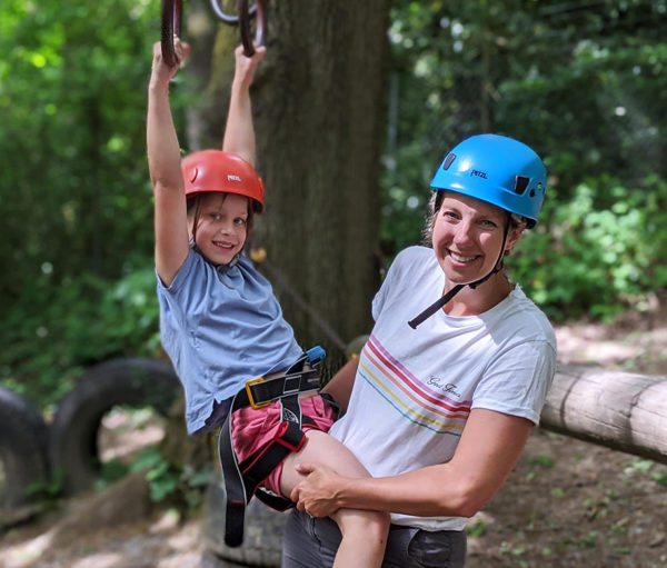 mother and daughter navigating low ropes