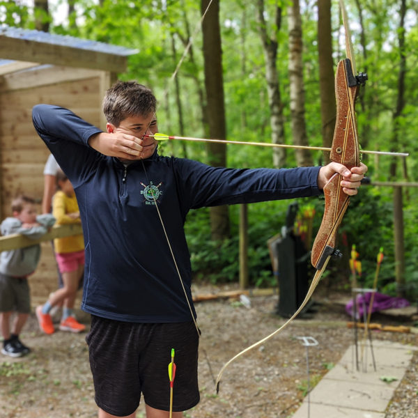 boy firing a bow and arrow