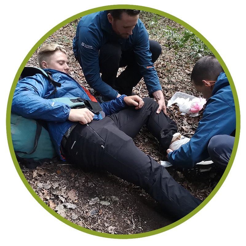 first aid course image of two men helping injured person