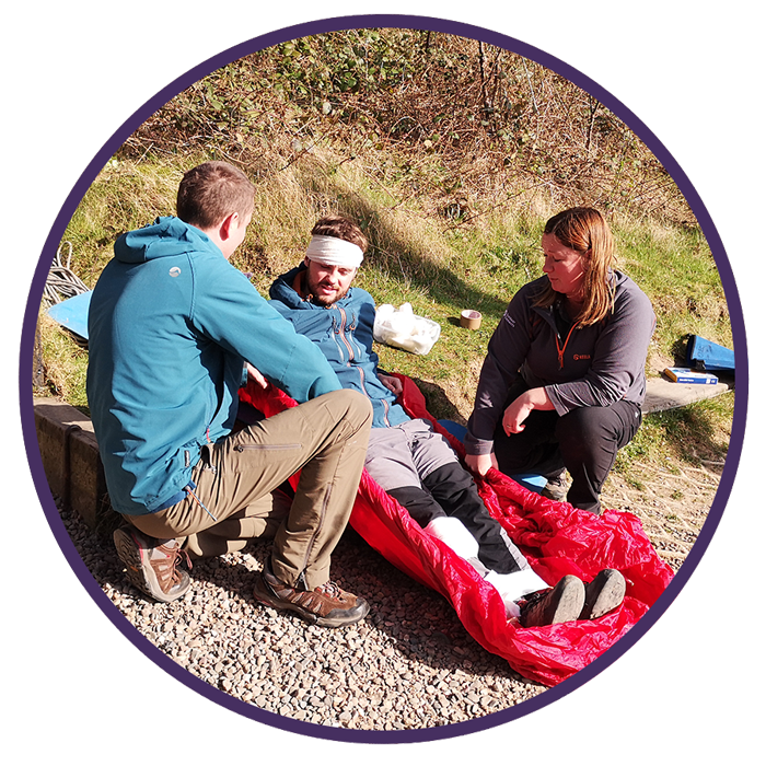 first aid course image including man with bandage on his head