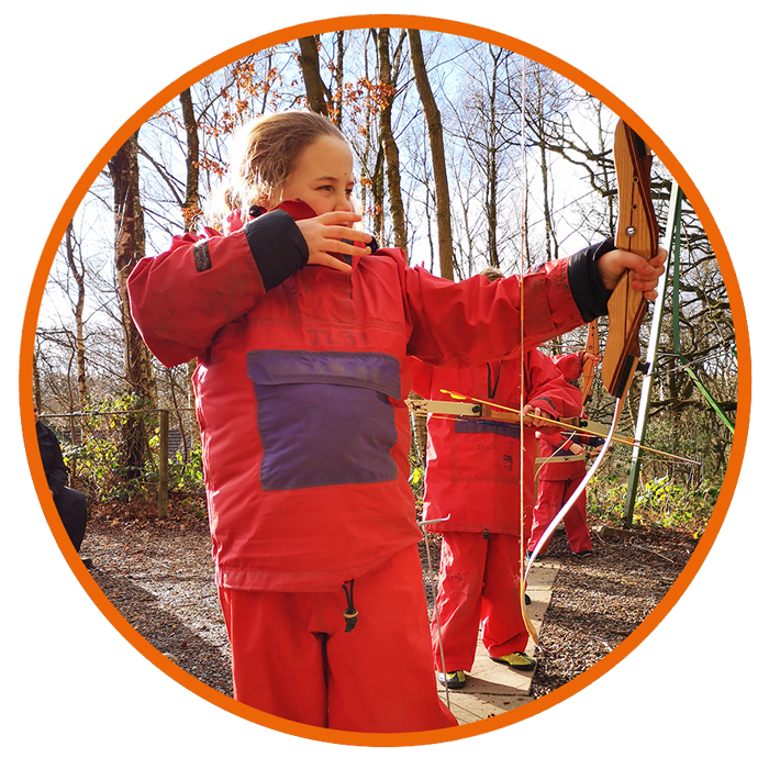girl in red firing a bow and arrow