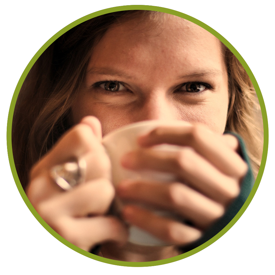 close up image of girl with a coffee mug